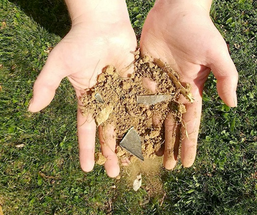 hands filled with dirt