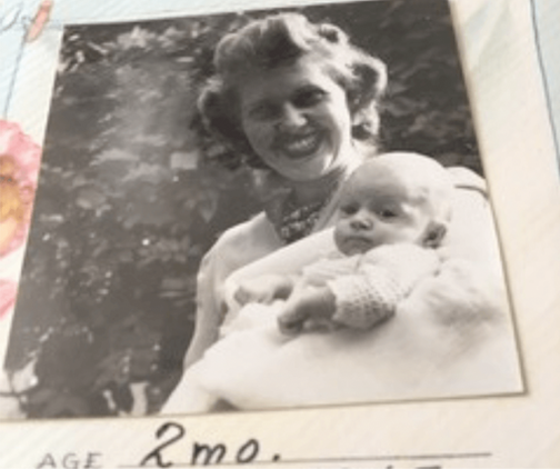 Old black and white photo of a mother holding her baby daughter